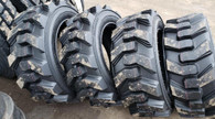 (4- tires ) 12-16.5 Carlisle Ultra Guard skid-steer 12PR tire 12/16.5 DEEP TREAD 12165