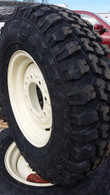 4- Tires and Wheels skid-steer snow tires LT 235/85r16 mounted and ready 2358516
