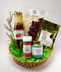 The #YEG Basket includes an assortment of local goodies from vendors at the community farmers markets around Edmonton, including Roasted Garlic Salt, BBQ Spice Rub, Sweet & Spicy BBQ sauce, Peppered Beef Jerky, Raspberry Chocolate Tea and kettle corn.  If you wish to add more delicious edibles, that can be arranged as well.