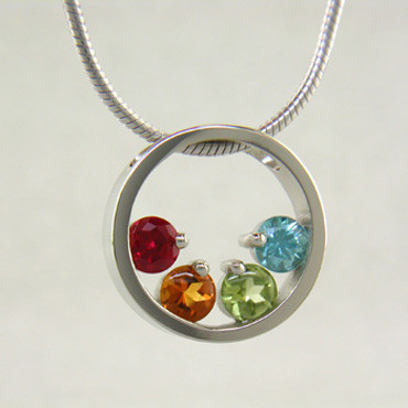 If you are looking for an elegant, classy, and modern birthstone pendant, you found it! Available for up to 6 gemstones (imitation birthstones), in Sterling Silver, and comes with a 1mm 16 inch snake chain. Unless otherwise requested, stones will always be centered at the bottom of the circle. If you would like different stone options, such as genuine Emerald, Ruby, or Sapphire, please call or email us. We can make this any way you like, and in most metals.  Please let us know how you would like yours, if different from the options listed here. This is a Special Order item (see Policy information for details), and ships in approximately 2 weeks.  Designed, and created in our studio by the artist Stuart J.