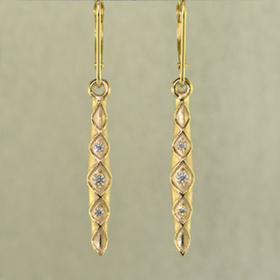 When you need just a touch of sparkle to jazz up your wardrobe, these 14 karat Yellow Gold diamond earrings are perfect. They are a perfect blend of traditional, and modern, to work with any outfit, and give you a confident feel, wether you are dressed up or dressed casual. Set with .12ct T.W. of Ideal cut Diamonds, with lever backs. Earrings measure 1 1/2 inches long.  Designed, and created in our studio by the artist Stuart J.