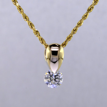 Simple and elegant, this Diamond Piercette® tear drop pendant sparkles from every angle. Specially set using a patented setting technique that allows the diamond to continuously move, and sparkle like crazy. This diamond pendant is made in 14 karat Yellow Gold with a .43ct. Diamond (G color, SI1 clarity), and includes a 14 karat Yellow Gold 1.1mm Diamond-cut rope chain. Pendant measures 3/8 inch long. Designed, and created in our studio by the artist Stuart J.  A Piercette® is a patented method of setting, with a gemstone that moves. The gem is set so that it swivels with every movement of the wearer, exhibiting extra sparkle.