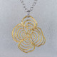 Flirty and fun, wearing this open flower motif pendant is sure to bring a smile to your face. Gold plated Sterling Silver.  Pendant measures 2 1/4 inches, and includes the Sterling Silver round link chain, 18 inches long.  Handcrafted in Northern Spain.