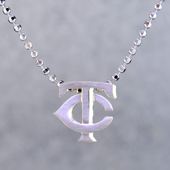 Inspired by today's modern woman, each pendant representing the 30 MLB teams captures the heart and spirit of every city and fan. Little Minnesota Twins pendant in solid Sterling Silver measures 1/2 inch long, and comes on a sparkling sterling silver ball chain, 18 inches long. Also available in 14 karat Yellow and Rose gold. What's your favorite team?  Designed and handcrafted by Alex Woo in New York City.