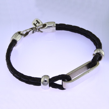 "For the man who is edgy and modern, this bracelet will make a statement. Hand-crafted in brown Leather surrounded by a Sterling Silver shiny loop and shiny Silver handmade accents on the sides of the bracelet. Measures 8"" long.  Made in northern California."