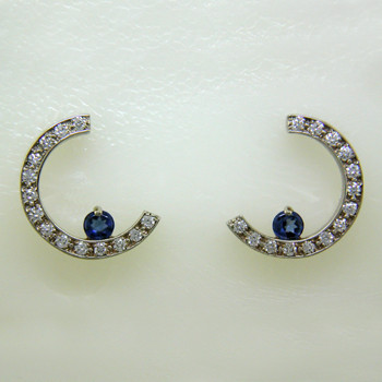 36945eadf Classic, elegant, and contemporary Sapphire and Diamond earrings in a crescent  moon shape.