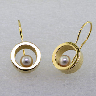 "These floating pearl earrings are modern and timeless. Classic circles in 14 karat Yellow Gold with 4.5mm very fine Akoya cultured Pearls, hanging on wires. Measure 1"" long.  Designed, and created in our studio by the artist Stuart J."