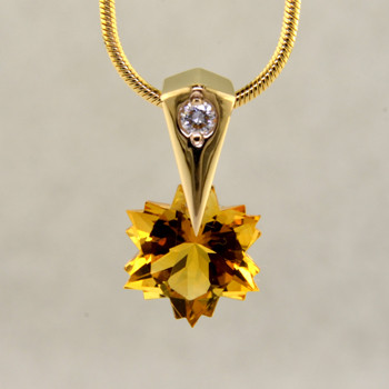 The hottest snowflake around! Custom cut, exclusively for us, in Canada. Dangling from a 14 karat yellow gold Piercette® pendant, with a perfectly cut sparkling 8mm Citrine snowflake cut gemstone, and accented with a single .03ct. Ideal cut Diamond. Includes a 14k yellow gold 1mm diameter, smooth snake chain, 16 inches long. Measures 1/2 inch long.  Designed and handmade by the artist Stuart J.  A Piercette® is a patented method of setting, with a gemstone that moves. The gem is set so that it swivels with every movement of the wearer, exhibiting extra sparkle.