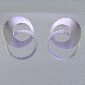 Fun, everyday endless double hoop earrings, handmade in Sterling Silver with posts, and a smooth matte finish. Measuring 1 1/4 inches long.    Designed and handmade in Istanbul, Turkey.