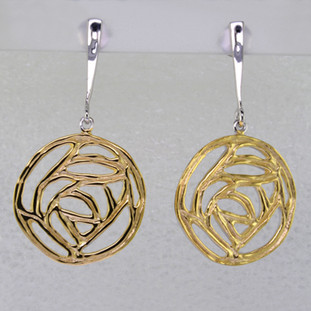 Easy, fun earrings you can wear anywhere. These earrings feel a little bit vintage, but a little bit modern too. Gold plated Sterling Silver, these earrings hang on dangle posts. Measure 1 3/4 inches long.  Handcrafted in northern Spain.
