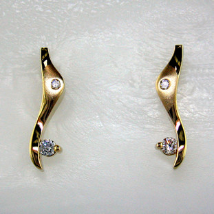 "Striking, modern diamond earrings in 14 karat yellow gold with .20ct. T.W. of ideal cut diamonds, with posts.  These elegant diamond earrings measure 3/4"".   Designed, and created in our studio by the artist Stuart J."