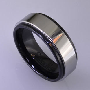 "For the innovative and unique man, this men's ring can be for many occasions. Wear it as a wedding ring, or just a stylish everyday fashion statement ring. This ring is ultra durable for the guy who plays rough. And no charge for re-sizing. This ring is 8mm wide in black ceramic, with a 6mm polished cobalt chrome overlay, polished to a silky smooth finish. Ring shown is a size 10, but call us with your finger size and we will make it just for you. Usually within just a few days.  This ring is hypoallergenic, and environmentally friendly. Made with Gem Ceramique, this ring uses high tech zirconia ceramic, virtually as hard as sapphire. Ultra durable and stylish, versatile and unique. It even has a Lifetime ""Peace of mind"" warranty against breakage.  Created by award winning jewelry artist Etienne Perret, and made in his studio in Camden, Maine.  This ring is hypoallergenic, and environmentally friendly. Made with Gem Ceramique, this ring uses high tech zirconia ceramic, virtually as hard as sapphire. Ultra durable and stylish, versatile and unique. It even has a Lifetime ""Peace of mind"" warranty against breakage.  Created by award winning jewelry artist Etienne Perret, and made in his studio in Camden, Maine."