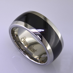 "For the innovative and unique man, this men's ring can be for many occasions. Wear it as a wedding ring, or just a stylish everyday fashion statement ring. This ring is ultra durable for the guy who plays rough. And no charge for re-sizing. This ring is 10mm wide with a slight dome, in polished cobalt chrome, with a 5mm black ceramic inlay, polished to a silky smooth finish. Ring shown is a size 10.5, but call us with your finger size and we will make it just for you. Usually within just a few days.  This ring is hypoallergenic, and environmentally friendly. Made with Gem Ceramique, this ring uses high tech zirconia ceramic, virtually as hard as sapphire. Ultra durable and stylish, versatile and unique. It even has a Lifetime ""Peace of mind"" warranty against breakage.  Created by award winning jewelry artist Etienne Perret, and made in his studio in Camden, Maine."