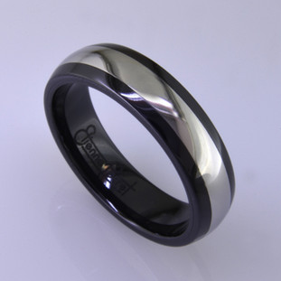 "For the innovative and unique man, this men's ring can be for many occasions. Wear it as a wedding ring, or just a stylish everyday fashion statement ring. This ring is ultra durable for the guy who plays rough. And no charge for re-sizing. This ring is 6mm wide with a slight dome, in polished black ceramic, with a 3mm cobalt chrome inlay, polished to a silky smooth finish. Ring shown is a size 10, but call us with your finger size and we will make it just for you. Usually within just a few days.  This ring is hypoallergenic, and environmentally friendly. Made with Gem Ceramique, this ring uses high tech zirconia ceramic, virtually as hard as sapphire. Ultra durable and stylish, versatile and unique. It even has a Lifetime ""Peace of mind"" warranty against breakage.  Created by award winning jewelry artist Etienne Perret, and made in his studio in Camden, Maine.  This ring is hypoallergenic, and environmentally friendly. Made with Gem Ceramique, this ring uses high tech zirconia ceramic, virtually as hard as sapphire. Ultra durable and stylish, versatile and unique. It even has a Lifetime ""Peace of mind"" warranty against breakage.  Created by award winning jewelry artist Etienne Perret, and made in his studio in Camden, Maine."