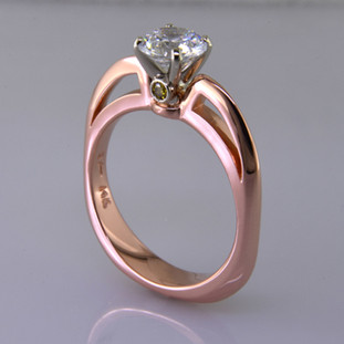 This beautiful engagement ring design with its simple, clean lines frames your diamond perfectly. The bottom has soft rounded corners for the ultimate comfort. This is a contemporary, but timeless design.    This elegant diamond engagement ring is priced in 14k white gold, and can be made in any karat or color of gold, and in platinum. This one is shown with a 1 carat round brilliant cut center (sold seperately), but we will make it for any size or shape gem. For a little extra sparkle, we added 2 yellow diamonds to the sides of the crown. A matching shadow wedding ring or a diamond wedding ring is available.  This custom designed engagement ring is individually crafted to be Perfectly You, and takes about 2 weeks to create. Call us for more information about how we can customize this design Just For You. Designed, and created in our studio by the artist Stuart J.