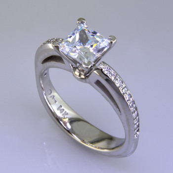 This beautiful diamond engagement ring design with its simple, clean lines frames your diamond perfectly. The bottom has soft rounded corners for the ultimate comfort. This is a contemporary, but timeless design.    This elegant diamond engagement ring is priced in 14k white gold, and can be made in any karat or color of gold, and in platinum. Set with .17ct. of ideal cut diamonds, this one is shown with a 1 carat princess cut center (sold seperately), but we will make it for any size. A matching shadow wedding ring or a diamond wedding ring is available.  This custom designed engagement ring is individually crafted to be Perfectly You, and takes about 2 weeks to create. Call us for more information about how we can customize this design Just For You. Designed, and created in our studio by the artist Stuart J.
