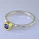 This cool, hip, and fun stackable ring is the start of your new collection. This ring will have many different looks when you stack it with other rings, or enjoy it alone in your everyday style. Hand finished in Sterling sliver with an 18 karat yellow gold bezel holding a beautiful 4.0mm round buff top tanzanite. Finger size 7. We will make this in any size you need in about ten days.  Designed, and created in our studio by the artist Stuart J.  This ring is also shown in other gemstone colors and sizes, which are sold separately, and can be stacked with all other rings in our stackables collection. You can also stack it with any ring you like. There are no rules. Call us with your favorite color, and we will customize this Just For You.