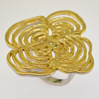 Flirty and fun, wearing this open flower motif ring is sure to bring a smile to your face. Gold plated Sterling Silver.  Ring measures 1 3/4 inches, and comes in a size 7.  Call us with your finger size and we will have it made just for you.  Please allow 3 weeks for delivery.    Handcrafted in Northern Spain.