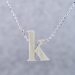 "What's your story? Begin with this Little ""K"" initial solid Sterling Silver pendant. Wear it alone, with other pendants, or layered with other necklaces. Comes with a sterling silver ball chain, 16 inches long. The pendant measures 1/4 inch long. Too cute!  Signified by a feminine sensibility and optimistic charm, Alex Woo's Little Icon Collections reinvent familiar symbols from the world around us into fresh and expressive designs.  Designed and handcrafted in our studio."