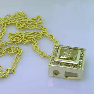 14 Karat green gold custom designed pendant with natural yellow princess cut diamonds and a 4ct. Princess cut yellow diamond center.
