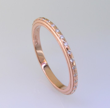 Sleek and modern rose gold diamond wedding ring to match our Katie Rose, or to wear seperately as an eternity or stackable ring. This diamond ring has 32 sparkling ideal cut diamonds weighing .16ct. Made in a size 6 3/4. Call for other sizes, or other gold options.  Made in our studio by the artist Stuart J.