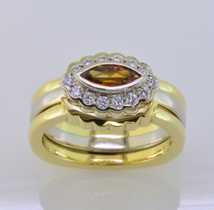 These fitted wedding rings perfectly compliment our Ginger engagement ring. Hand crafted in 18 karat yellow gold to bring out the color of the yellowish orange diamond center. The 2 wedding rings create the perfect frame to show off Ginger to her fullest. In case you only want to get one, they are priced individually. And, of course, we can make them in any color or karat of gold or platinum, or even with diamonds. Now there's an idea!  Custom designed and hand crafted in our studio by the artist Stuart J.