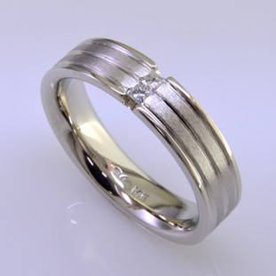Modern mans diamond wedding ring - classy and very cool. Crafted in 14 karat white gold, it's 6mm wide, with three continuous grooved lines, featuring two princess cut diamonds totaling one tenth carat. This ring has a rounded shape and comfort fit inside to make this ring the most comfortable it can be. Finger size is 11, and it can be sized, or custom made Just For You.  This diamond wedding ring is priced in 14k gold, and can be made in any karat or color of gold, and in platinum. Please allow 2 weeks for us to make it. It will be worth it!  Designed, and created in our studio by the artist Stuart J.