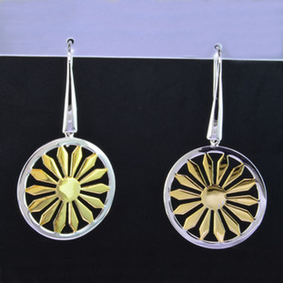 You can't help but feel sunny wearing these stylish earrings. A bold Yellow Gold plated sterling silver sunshine, encircled with a rhodium plated sterling silver border, that will bring a smile to your face. Hangs on silver wires. Measures 1 3/4 inches in diameter. An Exceptional Value. Hand-crafted by artisans in northern Spain.