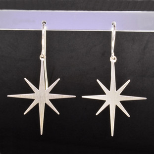 These earrings are not only beautiful, but the proceeds go to the Be the Light Charity. Sterling silver stars hanging on silver wires. Measures 1 3/4 inches long. Check out the website at www.urban-light.org.  Made in Istanbul.
