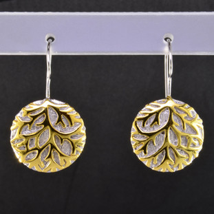 Gold branches stand out against a wintry white background in these nature inspired Sterling Silver earrings. Hanging on sterling silver wires. The earrings measure 1 inch long for a distinctive look. An Exceptional Value.  Handcrafted in Northern Spain.
