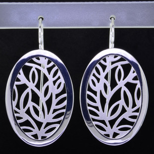 These oval open leaf motif design sterling silver earrings will make any outfit shine. Wear them with jeans or an evening out. With sterling silver ear wires. Measures 1 3/4 inches long. Handmade in Istanbul, Turkey.