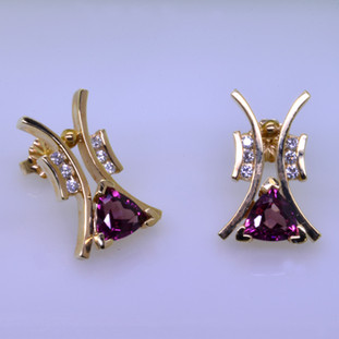 "Striking, modern diamond earrings in 14 karat yellow gold with .18ct. T.W. of ideal cut diamonds, and 1.73ct. of rhodolite garnet trillian gemstones with posts.  These elegant diamond earrings measure 3/4"".   Designed, and created in our studio by the artist Stuart J."