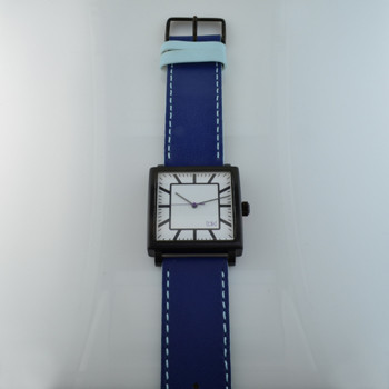 Here is time in full color. This Taki watch is fun, fun, fun! Fresh design, fresh color palette, all leather strap, a Japanese movement, and stainless steel bezels. Face measures 1 1/2inch square. Clean simple designs with so many fun colors, it will make you happy every time you wear it. And at a very affordable price