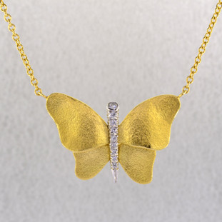 Inspired by natural colors and shapes, this sophisticated butterfly pendant is crafted in rich 19 karat yellow gold, with a platinum body, set with .12ct ct. total weight of sparkling diamonds. Hanging on an 18 karat yellow gold, 1.8mm anchor chain, this pendant is truly a knock out piece. Exceptional in every way, and designed by the acclaimed jewelrs of Aaron Henry, in their California studio.  A portion of the profits from the sale of this butterfly pendant will go to the Childrens Hospital and Clinics of Minnesota.