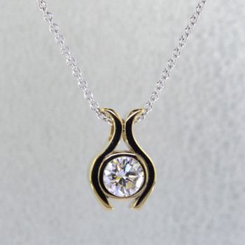 "Sweet, simple, modern tulip diamond solitare pendant. Wear it for work or play. Crafted in 14 karat white Gold with .71ct. diamond center, hanging on a 14 karat white gold cable chain in 18"". Measure 1/2 inch long.  Designed, and created in our studio by the artist Stuart J."