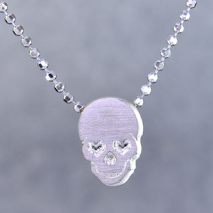 "What's your story? Begin with this Little Rockstar skull solid Sterling Silver charm. Wear it alone, with other charms (such as the Mini ""s"" shown, and sold separately), or layered with other necklaces. Comes with a sterling silver ball chain, 16 inches long. The charm measures 1/4 inch long. Too cute!  Signified by a feminine sensibility and optimistic charm, Alex Woo's Little Icon Collections reinvent familiar symbols from the world around us into fresh and expressive designs.  Designed and handcrafted by Alex Woo in New York City."