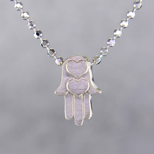 What's your story? Begin with this Little Faith Hamsa Hand, solid Sterling Silver charm. Wear it alone, with other charms, or layered with other necklaces. Comes with a sterling silver ball chain, 16 inches long. The charm measures 1/4 inch long. Too cute!  Signified by a feminine sensibility and optimistic charm, Alex Woo's Little Icon Collections reinvent familiar symbols from the world around us into fresh and expressive designs.  Designed and handcrafted by Alex Woo in New York City.