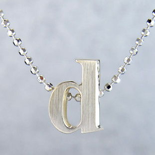 "What's your story? Begin with this Little ""d"" initial, solid Sterling Silver pendant. Wear it alone, with other pendants, or layered with other necklaces. Comes with a sterling silver ball chain, 16 inches long. The pendant measures 1/4 inch long. Too cute!  Signified by a feminine sensibility and optimistic charm, Alex Woo's Little Icon Collections reinvent familiar symbols from the world around us into fresh and expressive designs.  Designed and handcrafted by Alex Woo in New York City."