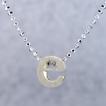 """What's your story? Begin with this Little """"e"""" initial, solid Sterling Silver pendant. Wear it alone, with other pendants, or layered with other necklaces. Comes with a sterling silver ball chain, 16 inches long. The pendant measures 1/4 inch long. Too cute!  Signified by a feminine sensibility and optimistic charm, Alex Woo's Little Icon Collections reinvent familiar symbols from the world around us into fresh and expressive designs.  Designed and handcrafted by Alex Woo in New York City."""