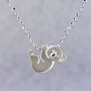 What's your story? Begin with this Little Koala Bear, solid Sterling Silver pendant. Wear it alone, with other pendants, or layered with other necklaces. Comes with a sterling silver ball chain, 16 inches long. The pendant measures 1/4 inch long. Too cute!  Signified by a feminine sensibility and optimistic charm, Alex Woo's Little Icon Collections reinvent familiar symbols from the world around us into fresh and expressive designs.  Designed and handcrafted by Alex Woo in New York City.