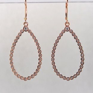 These jaw-dropping and elegant dangle diamond earrings will make you the envy of the party (or office, or grocery store, or...you know). Crafted in 14 karat rose gold, with almost 3/4 carat of sparkling ideal cut diamonds. Set in bezels so they feel soft and smooth, you will feel like a queen with these on your ears! On rose gold lever backs. Measures 2 inches long.  Made in our studio by the artist Stuart J.  These earrings can be customized to be Perfectly You, and can be made in any karat or color of gold, and in platinum.