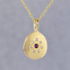 This sweet pendant has a special, hand applied finish that shimmers when you wear it. Beautiful and rich 14 karat yellow gold drop, sprinkled with .06 carat total weight of ideal cut diamonds, with a glowing rhodolite garnet gemstone in the center. Comes with an sixteen inch, 14 karat yellow gold rope chain. Pendant measures 5/8 inches long.     Designed and created in our studio by the artist Stuart J.