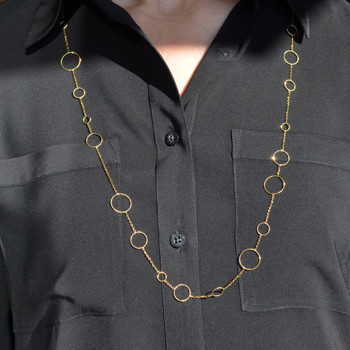 """Feels like the 60's all over again.  14 Karat yellow gold circle waterfall chain.  Wearing this will make you feel fun and flirty. Wear with a dress, or a casual shirt, day or night. This chain is 34"""" long."""