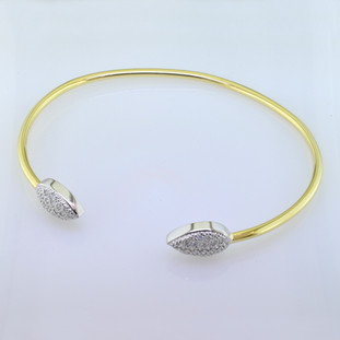 Going out for a dinner date, or just being casual, this cool cuff bracelet fits the bill. Custom made by our talented artist, Stuart J, this bracelet blends yellow gold and white gold seamlessly. A perfect compliment to any outfit, that will layer nicely with your other bracelets. Beautiful ideal cut diamonds set in pear shapes, weigh 0.30 carat T.W., and sparkle like crazy. Hand-made in our studio with recycled gold. What could be better!