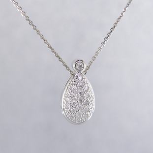 Timeless and elegant, this diamond pendant will dazzle! The perfect diamond pendant to layer, or wear alone.  Sparkling ideal cut diamonds, weighing 0.18 carat T.W., are set in 14 karat white gold. This beautifully sweet diamond pendant measures a 1/2 inch long and floats on a white gold cable chain, 16 inches long.  Designed, and created in our studio by the artist Stuart J.