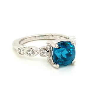 We carefully picked this blue zircon gemstone because it reminds us of our favorite Caribbean island. This spectacular gemstone ring, has an amazing and vibrant cushion cut electric Blue Zircon, weighing 3.62ct., with meticulously set marquise diamonds and ideal cut round diamonds totaling 0.22ct. Created in recycled 14 karat white gold, and made to last a lifetime. Finger size is a 7, but we can adjust it for your finger. Designed, and created in our studio by the artist, Stuart J.