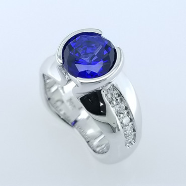 We love to make dreams come true, and always make everything unique. We think we accomplished both with this beautiful sapphire and diamond ring. We hand crafted this beauty in 14 karat White gold, and set a half carat of ideal cut diamonds, and an amazing 3.17 carats Chatham(r) Created round Blue Sapphire. All we can say is WOW!   This elegant ring is available in any karat or color of gold, and in platinum, set with your stones or ours.  Designed and created in our studio by the artist, Stuart J. Adelman.