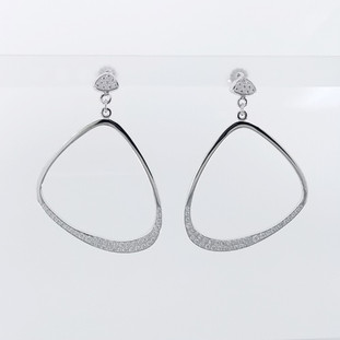 Every girl needs a pair of fabulous diamond hoop earrings. So we created these Unique, diamond hoops in 14 karat white recycled gold, pave' set with super sparkly ideal cut diamonds totaling just over One carat, dangling from diamond pave' studs. Measuring 1 1/4 inches. Truly a must for that special lady, or yourself!  Designed and created in our studio, by the artist Stuart J. Adelman.