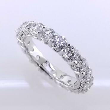 Timeless and elegant diamond eternity band created in 14 karat white gold and surrounded by 19-ideal cut round diamonds totaling 2.28ct.( this is for a size 7 finger, any other sizes are subject to price changes) Call for pricing!  Made in our studio by master artist Stuart J.
