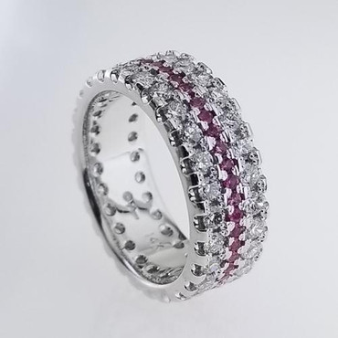 This timeless and classic anniversary band is a must for that special occasion. Created in 14 Karat white gold, setting 2 rows of 1.82ct. of Lab Grown sparkly diamonds, and a single middle row of beautiful bright pink sapphires .45ct. This ring measures 1/4 inches and is ready in a size 6 1/2.  We can custom make any finger size for you, but depending on the size, there will be a price adjustment. Please call us with finger size, and we will give you an updated price.  Custom designed and handcrafted in our studio, by the artist Stuart J.